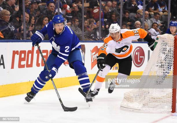 Toronto Maple Leafs defenseman Ron Hainsey battles for a puck with Philadelphia Flyers center Jori Lehtera in the third period during a game between...