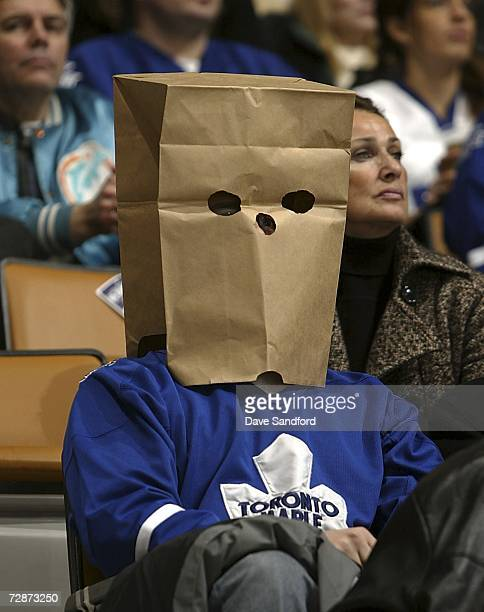 Toronto Maple Leafs fan sits in the stands as the Washington Capitals take on the Toronto Maple Leafs in their NHL game at the Air Canada Centre...
