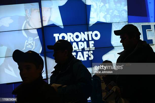 Toronto Maple Leafs fans pass a logo for the team at the ACC on the home opener on January 21 Rene Johnston/ Toronto Star