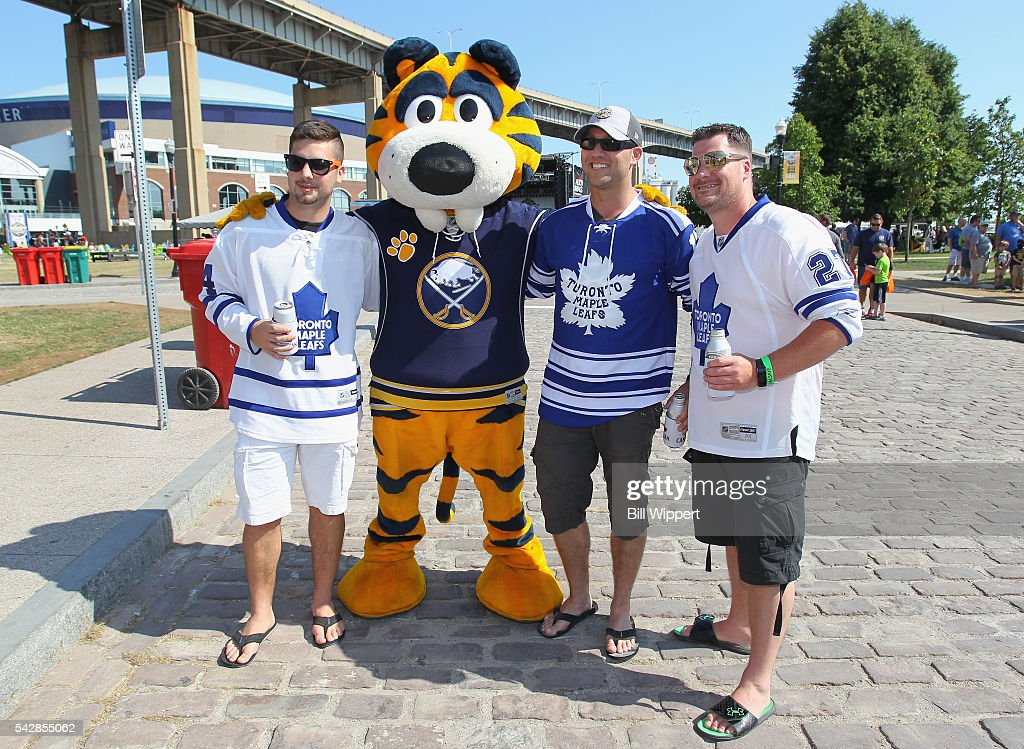 Toronto Maple Leafs fans pose with the Buffalo Sabres mascot Sabretooth during the Fan Fest as part of the 2016 NHL Draft at Canelside on June 24, 2016 in Buffalo, New York.