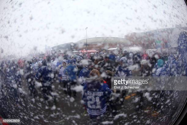 Toronto Maple Leafs fans stand in the spectator plaza during the 2014 Bridgestone NHL Winter Classic on January 1 2014 at Michigan Stadium in Ann...