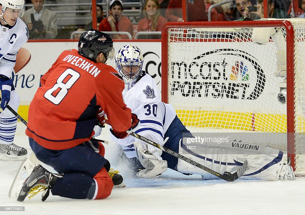 Toronto Maple Leafs goalie Ben Scrivens (30) makes a save against Washington Capitals left wing Alex Ovechkin (8), after Ovechkin got hooked to the ice, in the second period at the Verizon Center in Washington, D.C., Tuesday, April 16, 2013.