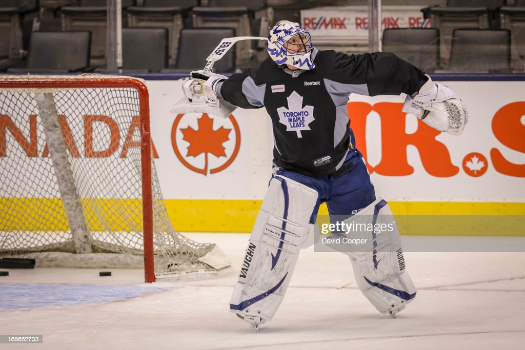 Toronto Maple Leafs goalie Ben Scrivens (30) smashes his goalie stick against the net before tossing it into the corner during practice.