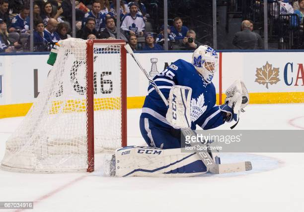 Toronto Maple Leafs goalie Curtis McElhinney saves a puck during the first period in a game against the Columbus Blue Jackets on April 9 at Air...