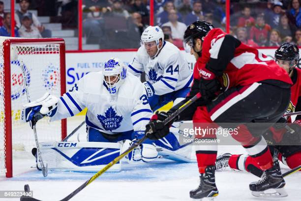 Toronto Maple Leafs goalie Curtis McElhinney scrambles cross the crease tracking a rebound during second period National Hockey League preseason...