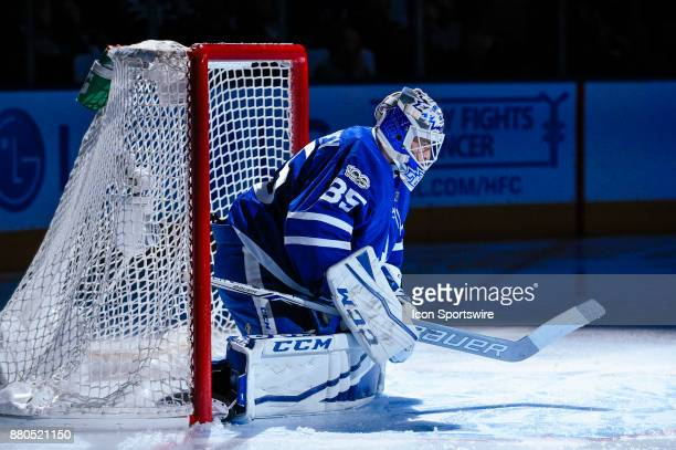Toronto Maple Leafs Goalie Curtis McElhinney stretches before the NHL regular season hockey game between the Washington Capitals and Toronto Maple...