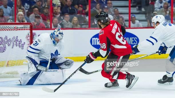Toronto Maple Leafs Goalie Frederik Andersen makes a chest save against Ottawa Senators Left Wing Mike Hoffman as Toronto Maple Leafs Defenceman Ron...