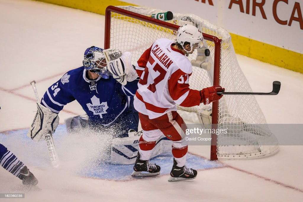TORONTO, ON- SEPTEMBER 28 - Toronto Maple Leafs goalie James Reimer (34) finally get beat high glove by Detroit Red Wings right wing Mitchell Callahan (57) late in the 3rd to make it 3-1 as the Toronto Maple Leafs host the Detroit Red Wings at the Air Canada Centre in Toronto, September 28, 2013.