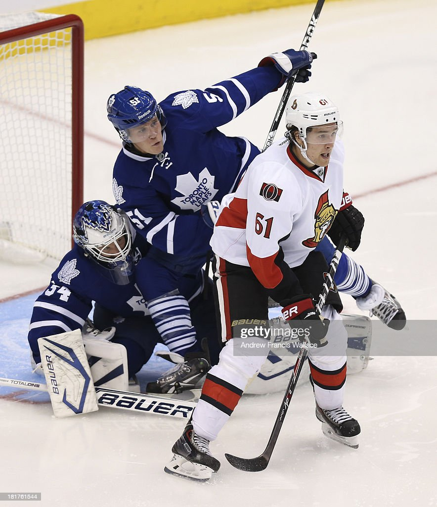 TORONTO, ON - SEPTEMBER 24 -Toronto Maple Leafs goalie James Reimer is run in to by defenseman Jake Gardiner as Ottawa Senators Mark Stone sets up a screen during second period NHL preseason play at the Air Canada Centre in Toronto, September 24, 2013.
