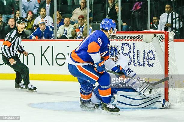 Toronto Maple Leafs Goalie Jhonas Enroth makes save on shot by New York Islanders Center John Tavares during the Toronto Maple Leafs and New York...