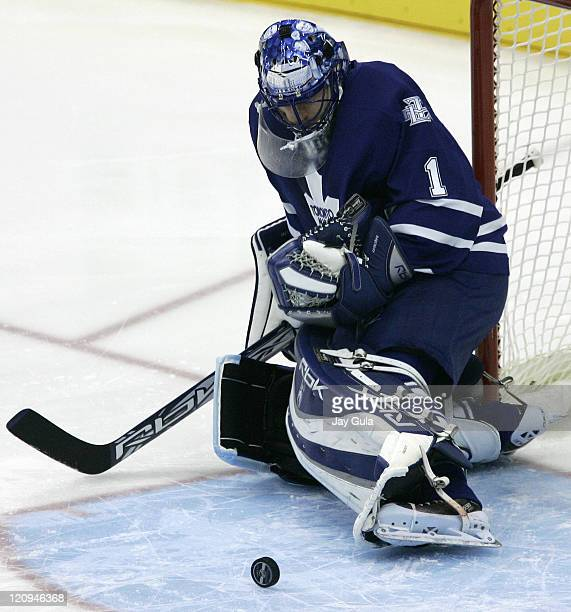 Toronto Maple Leafs goaltender Andrew Raycroft is about to pounce on this rolling puck in the crease vs the Atlanta Thrashers in NHL action at the...