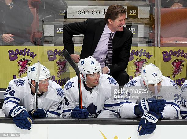 Toronto Maple Leafs head coach Mike Babcock looks on from the bench during the game against the Anaheim Ducks on January 6 2016 at Honda Center in...