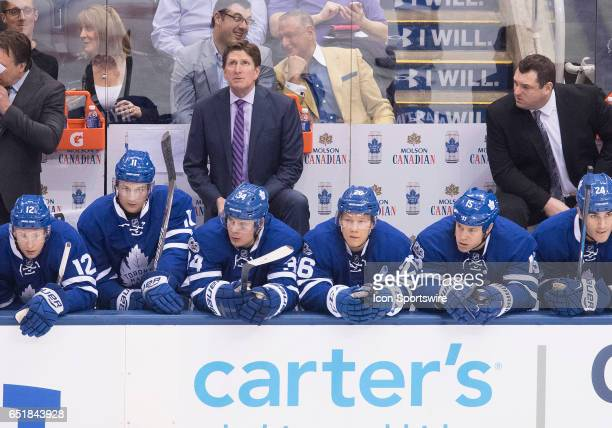 Toronto Maple Leafs head coach Mike Babcock looks up at the scoreboard during the first period in a game against the Detroit Red Wings at Air Canada...