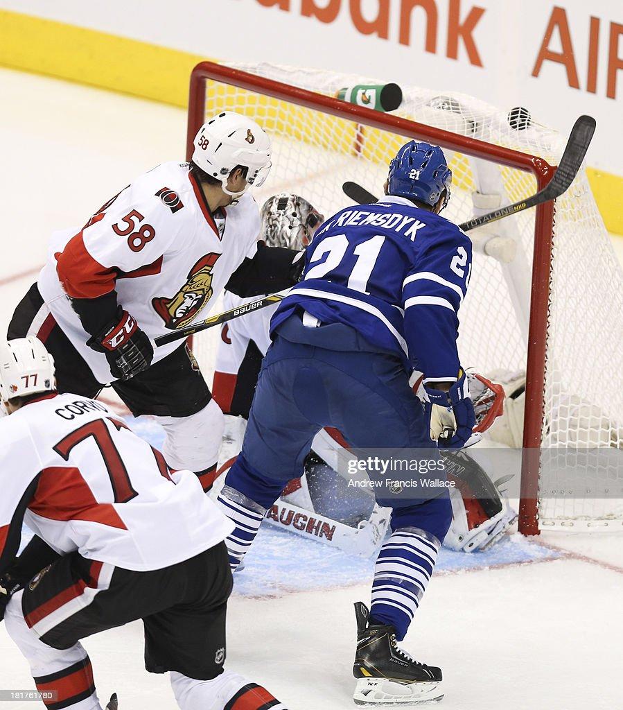 TORONTO, ON - SEPTEMBER 24 -Toronto Maple Leafs James van Reimsdyk scores on Ottawa Senators Robin Lehner during second period NHL preseason play at the Air Canada Centre September 24, 2013. Senators defenseman Michael Sdao (58) and Joe Corvo (77) are shown in the frame.