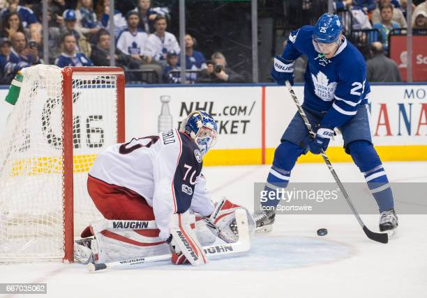 Toronto Maple Leafs left wing James van Riemsdyk battles for a rebound in front of Columbus Blue Jackets goalie Joonas Korpisalo during the second...