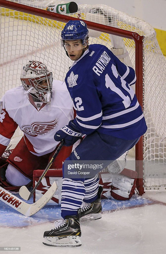 TORONTO, ON- SEPTEMBER 28 - Toronto Maple Leafs left wing Mason Raymond (12) in front of the Red Wings net during the game as the Toronto Maple Leafs defeated the Detroit Red Wings 3-1 at the Air Canada Centre in Toronto, September 28, 2013.