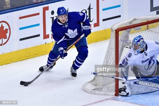 Toronto Maple Leafs Left Wing Zach Hyman controls the puck behind the net of Tampa Bay Lightning Goalie Andrei Vasilevskiy during the regular season...