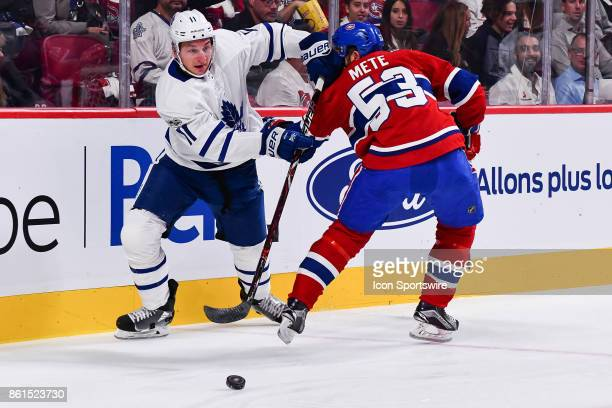 Toronto Maple Leafs Left Wing Zach Hyman passes the puck before Montreal Canadiens Defenceman Victor Mete stops him during the Toronto Maple Leafs...
