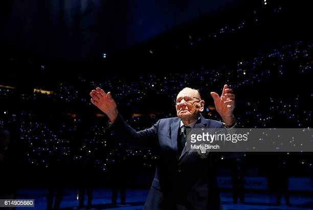 Toronto Maple Leafs legend Johnny Bower waves to fans during the opening ceremony for the Leafs 100th season at the Air Canada Centre on October 15...