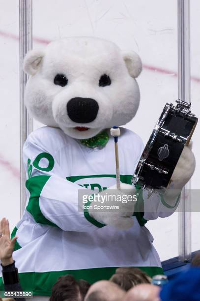 Toronto Maple Leafs Mascot Carlton the Bear cheers during the NHL regular season game between the Toronto Maple Leafs and the Chicago Blackhawks on...