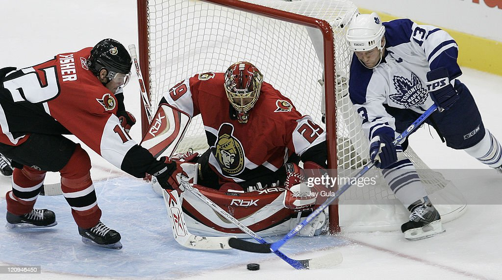 Toronto Maple Leafs <a gi-track='captionPersonalityLinkClicked' href=/galleries/search?phrase=Mats+Sundin&family=editorial&specificpeople=201858 ng-click='$event.stopPropagation()'>Mats Sundin</a> #13 can't get the puck past goaltender <a gi-track='captionPersonalityLinkClicked' href=/galleries/search?phrase=Martin+Gerber&family=editorial&specificpeople=206957 ng-click='$event.stopPropagation()'>Martin Gerber</a> of the Ottawa Senators as <a gi-track='captionPersonalityLinkClicked' href=/galleries/search?phrase=Mike+Fisher+-+Ice+Hockey+Player&family=editorial&specificpeople=204732 ng-click='$event.stopPropagation()'>Mike Fisher</a> #12 trys to help out in the NHL season opener for both teams at the Air Canada Centre in Toronto, Canada. October 4, 2006.
