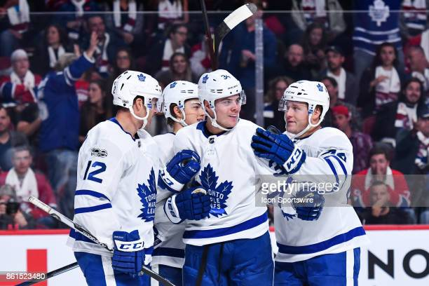 Toronto Maple Leafs players celebrating their second goal of the game scored by Toronto Maple Leafs Center Auston Matthews during the Toronto Maple...