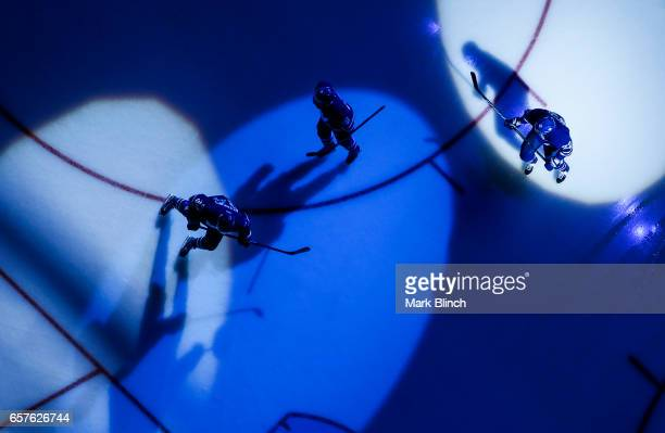 Toronto Maple Leafs players skate in the spotlight prior to the game against the New Jersey Devils at the Air Canada Centre on March 23 2017 in...