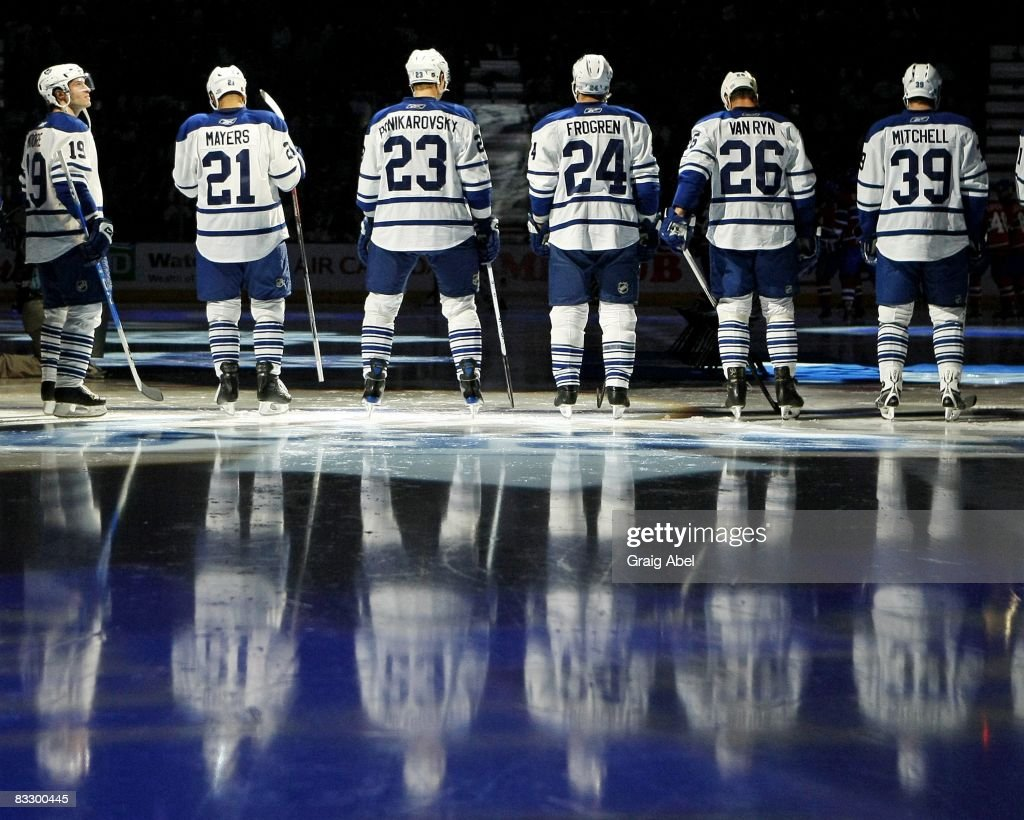 Toronto Maple Leafs players stand for the National Anthem prior to the game against the Montreal Canadiens on October 11 2008 at the Air Canada...