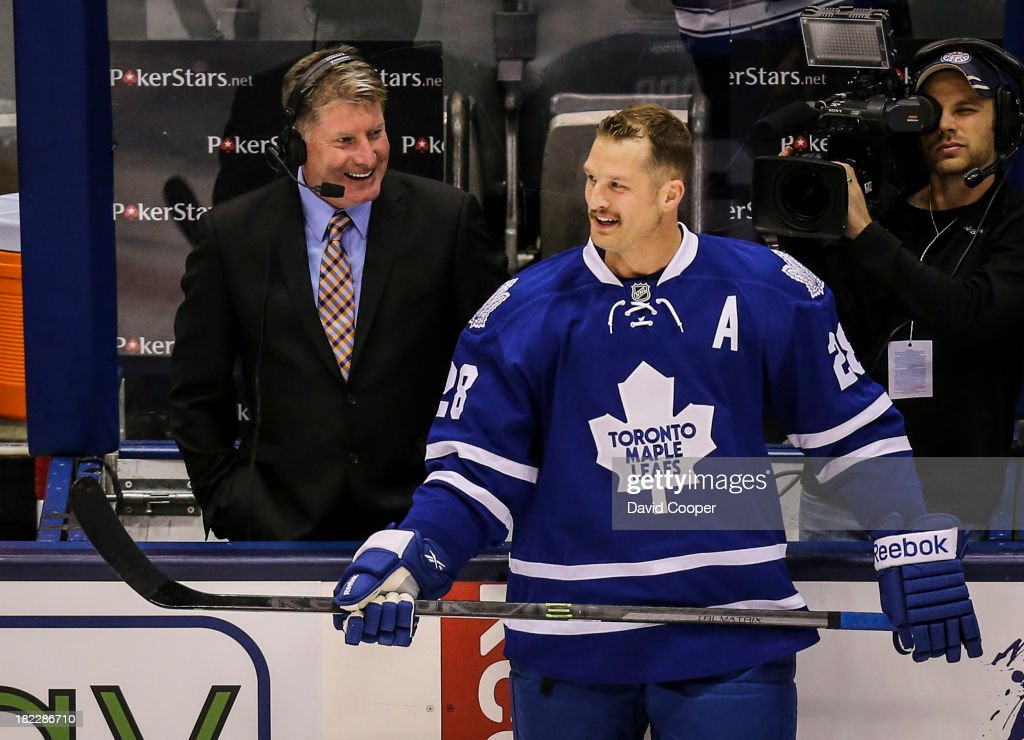 TORONTO, ON- SEPTEMBER 28 - Toronto Maple Leafs right wing Colton Orr (28) jokes with broadcaster and former goalie Glenn Healy during the warm-up as the Toronto Maple Leafs host the Detroit Red Wings at the Air Canada Centre in Toronto, September 28, 2013.