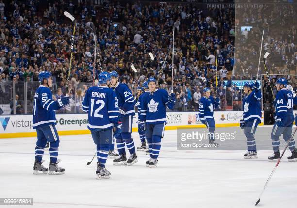 Toronto Maple Leafs right wing Connor Brown and Toronto Maple Leafs defenseman Jake Gardiner acknowledge the crowd at the end of the third period in...