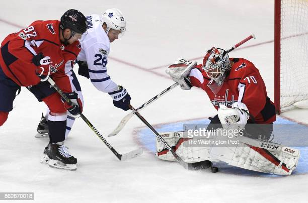 WASHINGTON DC OCTOBER Toronto Maple Leafs right wing Connor Brown gets the puck between the legs of Washington Capitals goalie Braden Holtby for a...