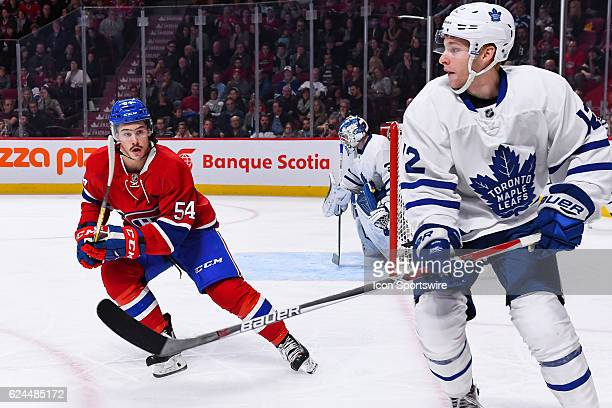 Toronto Maple Leafs Right Wing Connor Brown just passed the puck and Montreal Canadiens Left Wing Charles Hudon about to hit himduring the Toronto...
