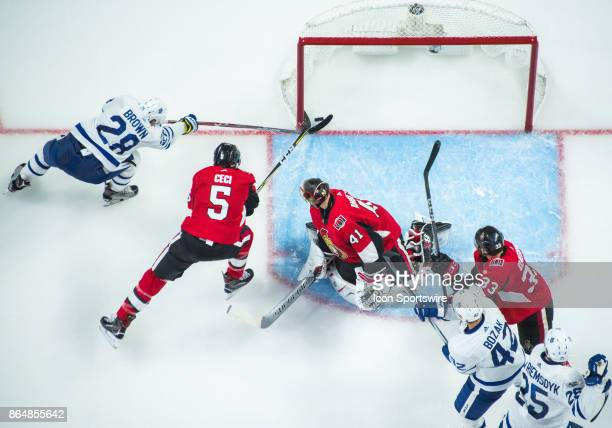 Toronto Maple Leafs Right Wing Connor Brown makes sure the puck is over the line as Toronto Maple Leafs Left Wing James van Riemsdyk scores the Leafs...
