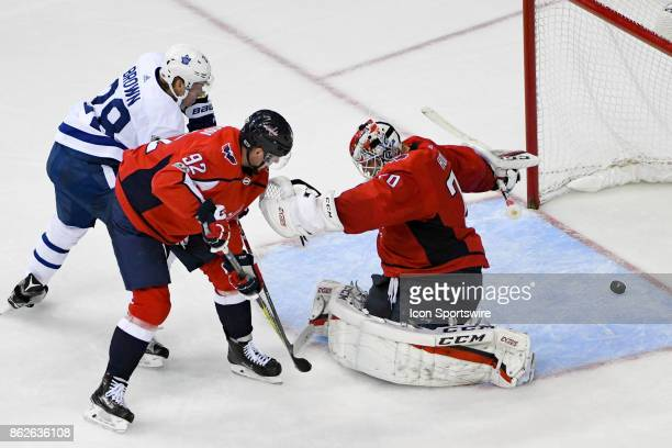 Toronto Maple Leafs right wing Connor Brown scores in a the third period against Washington Capitals goalie Braden Holtby and center Evgeny Kuznetsov...