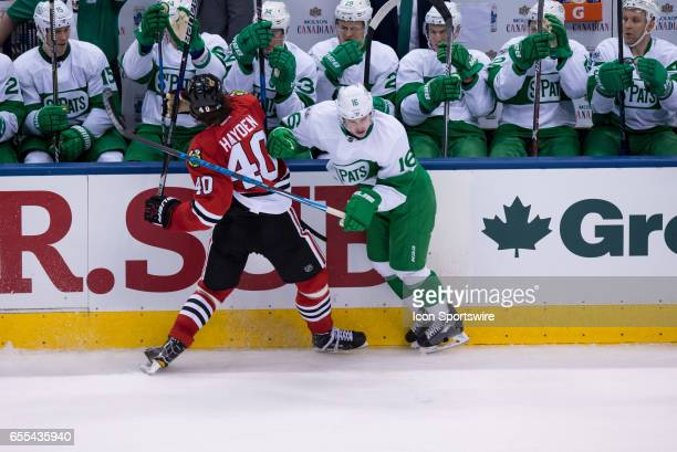Toronto Maple Leafs Right Wing Mitch Marner checks Chicago Blackhawks Right Wing John Hayden during the NHL regular season game between the Toronto...