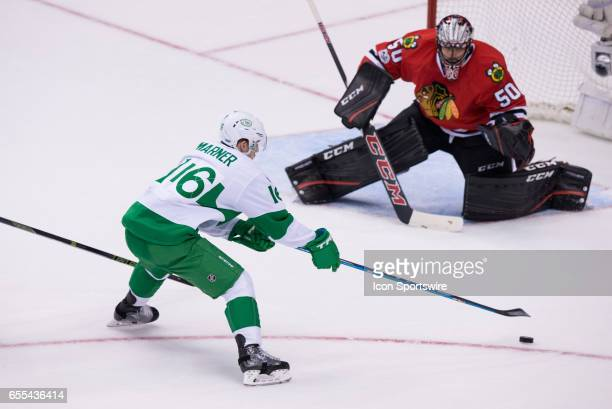Toronto Maple Leafs Right Wing Mitch Marner shoots the puck on Chicago Blackhawks Goalie Corey Crawford during the NHL regular season game between...