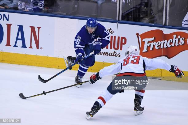 Toronto Maple Leafs Right Wing Mitchell Marner passes the puck past Washington Capitals Center Jay Beagle during to the Round 1 Game 4 of the NHL...