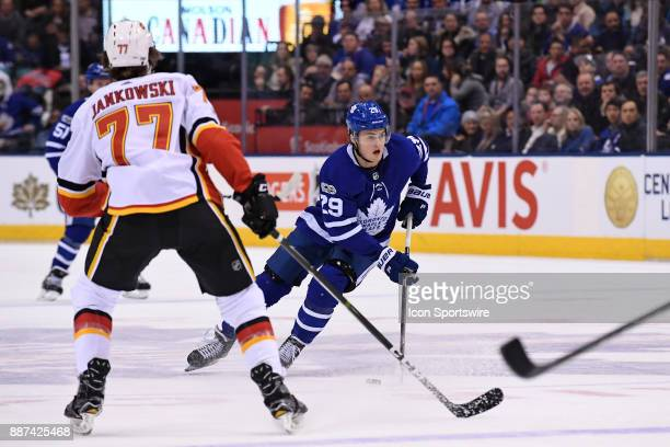 Toronto Maple Leafs Right Wing William Nylander controls the puck in front of Calgary Flames Center Mark Jankowski during the NHL regular season game...