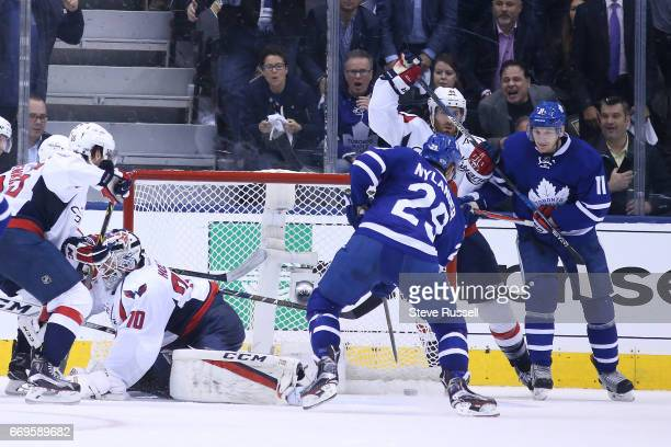 TORONTO ON APRIL 17 Toronto Maple Leafs right wing William Nylander ties the score at threes as he slips the puck past Braden Holtby as the Toronto...