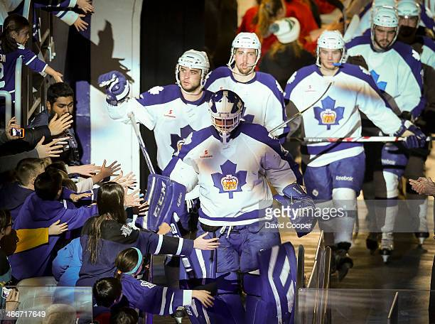 Toronto Marlies defence man TJ Brennan reaches out to touch the fans hands as the team comes onto the ice The Toronto Marlies beat the Lake Erie...