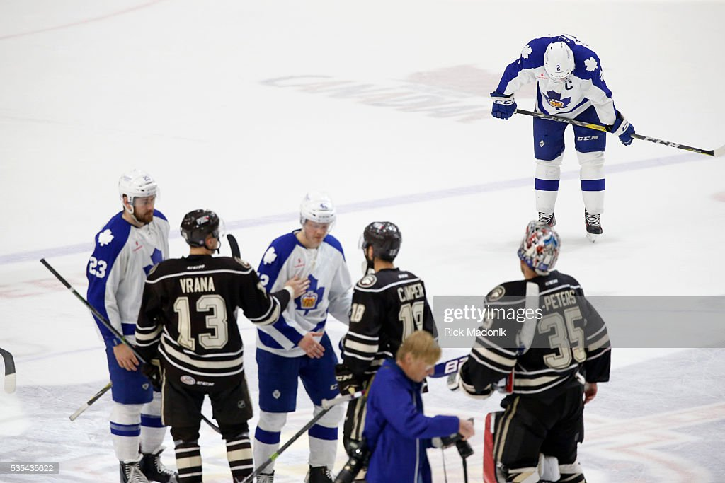 Toronto Marlies defenseman Andrew Campbell (2) bows his head as the teams line up to shake hands. Toronto Marlies V Hersey Bears during 3rd period play of Game 5 of AHL playoff action at the Ricoh Coliseum. Marlins lose 3-2 and Hersey wins the series 4-1. Toronto Star/Rick Madonik