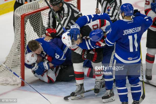 Toronto Marlies defenseman Andrew Nielsen took some offence to a highly placed stick by Albany Devils left wing Ben Thomson which lead to this little...