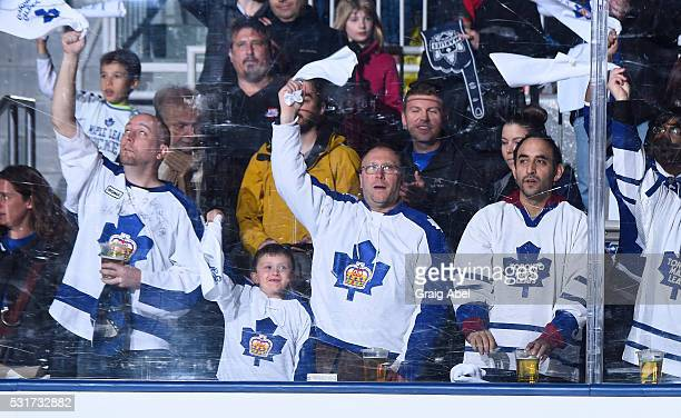 Toronto Marlies fans cheer on their team during AHL playoff game action against the Albany Devils on May 14 2016 at Ricoh Coliseum in Toronto Ontario...