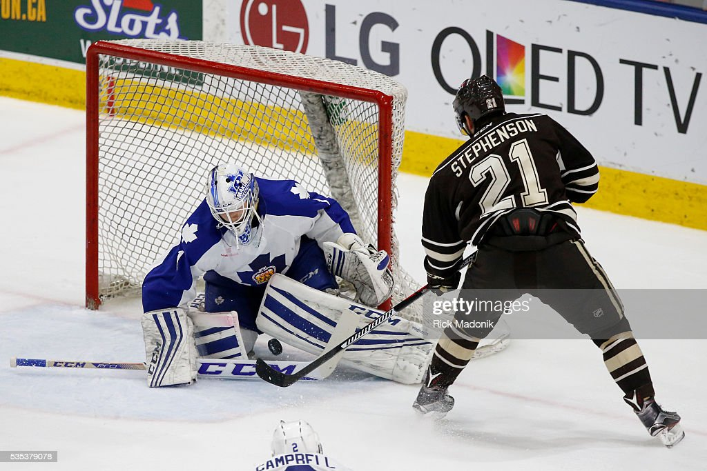 Toronto Marlies goalie Antoine Bibeau (1) makes the stop on Hershey Bears center Chandler Stephenson (21). Toronto Marlies V Hersey Bears during 2nd period play of Game 5 of AHL playoff action at the Ricoh Coliseum. Hersey leads the series 3-1. Toronto Star/Rick Madonik