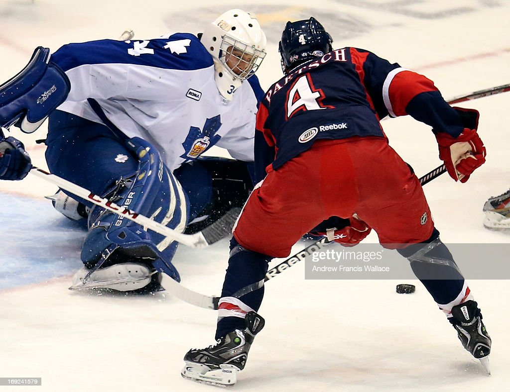 Toronto Marlies goalie Drew MacIntyre (L) makes a save in front of Grand Rapids Griffins Nathan Paetsch (4) during first period action in Game 6 of the AHL Western Conference semifinals.