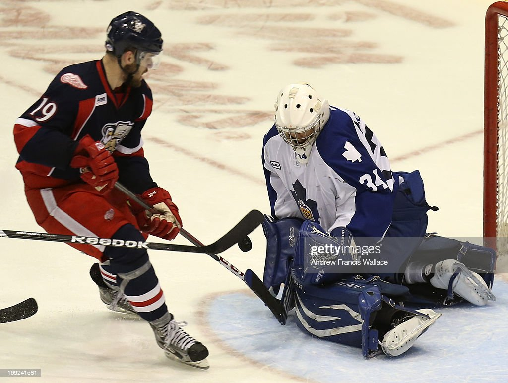 Toronto Marlies goalie Drew MacIntyre (R) makes a save on Grand Rapids Griffins Riley Sheahan (19) during second period action in Game 6 of the AHL Western Conference semifinals.