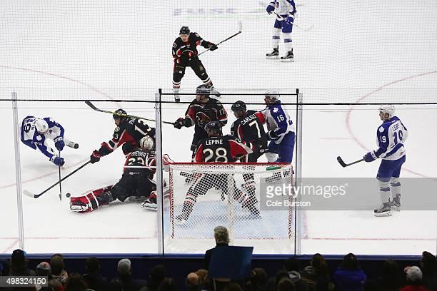 TORONTO ON NOVEMBER 22 Toronto Marlies' Matt Frattin tries to get a goal passed Binghamton Senators' defensemen and goaltender Chris Dredger during...