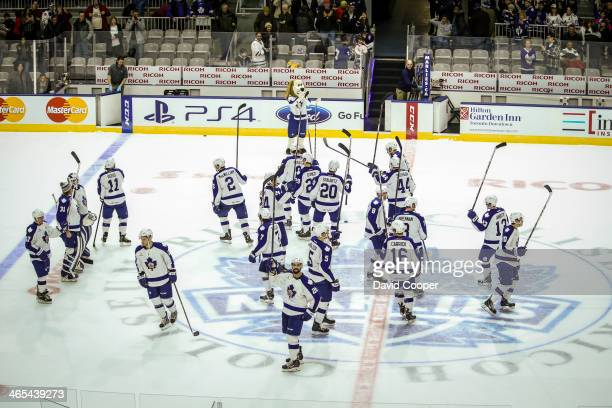 Toronto Marlies players salute their fans after the game as theToronto Marlies beat the Lake Erie Monsters 32 in a shoot out at the Ricoh Coliseum in...