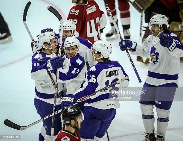 Toronto Marlies Stuart Percy celebrates with team mates after he scores his first goal of the year as as theToronto Marlies take on the Lake Erie...