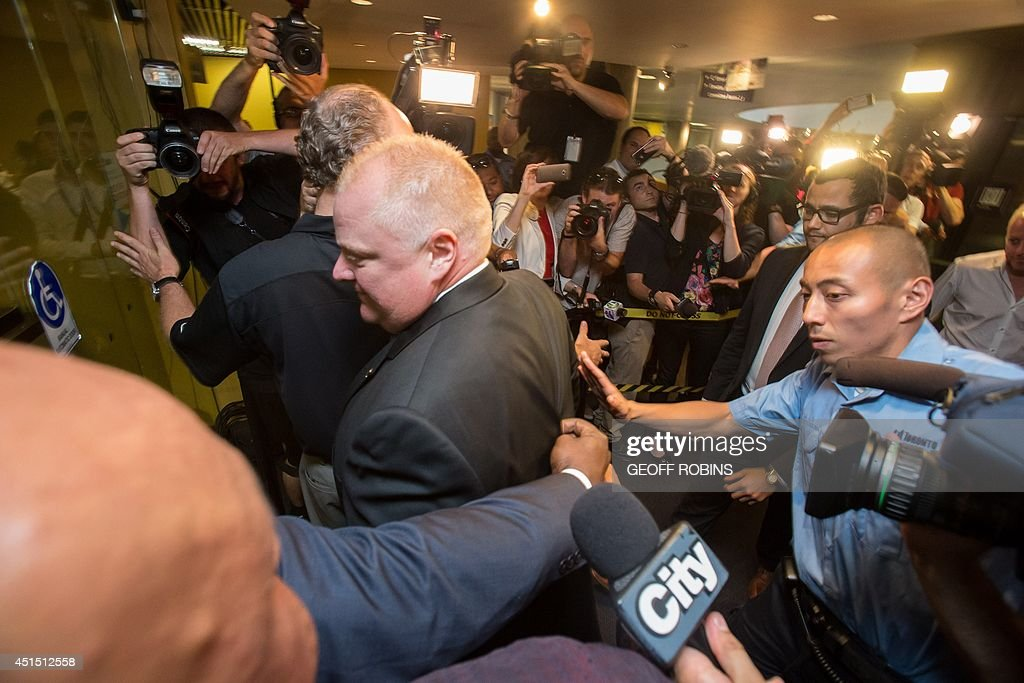 Toronto Mayor Rob Ford arrives at his office at city hall in Toronto on June 30, 2014 amid a crush of cameras. The crack-smoking mayor Rob Ford returned to work more popular than ever after a stint in rehab for his internationally publicized alcohol and drug abuse.